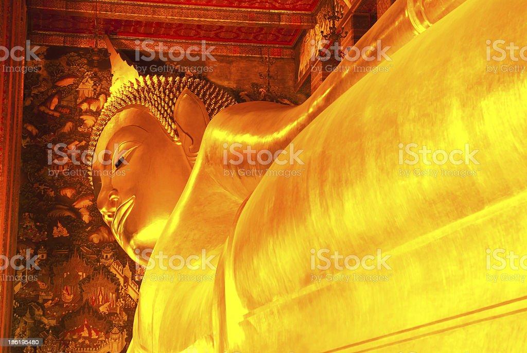 reclining buddha gold statue royalty-free stock photo