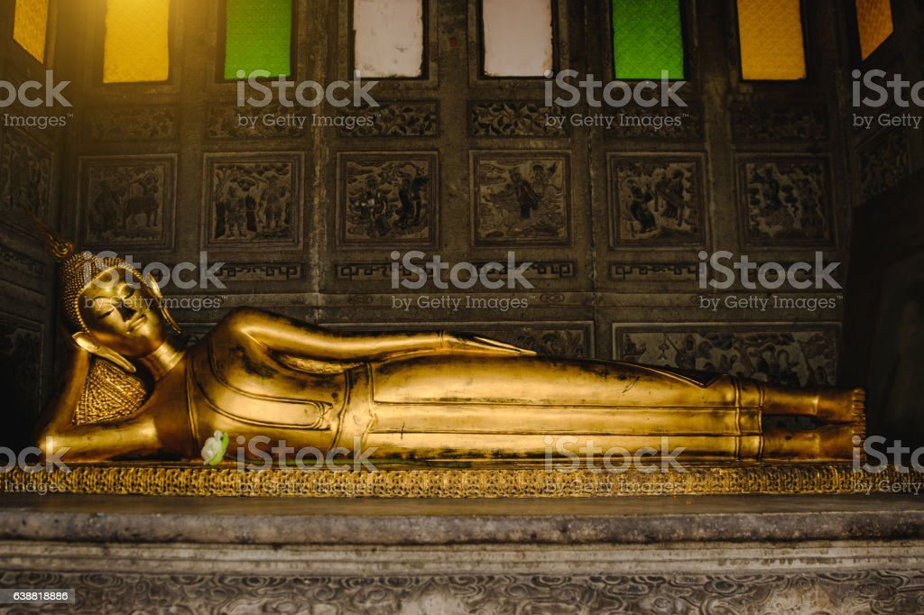 Reclining Buddha gold statue stock photo