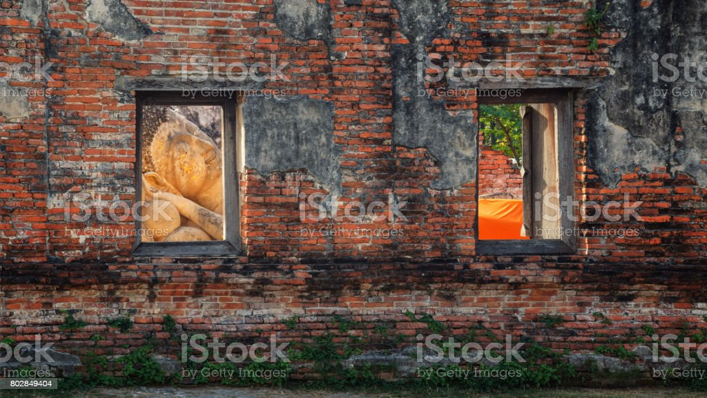 Reclining Buddha in a Ruined Hall of Phutthaisawan Temple in Ayutthaya Historical Park, UNESCO World Heritage Site in Thailand stock photo
