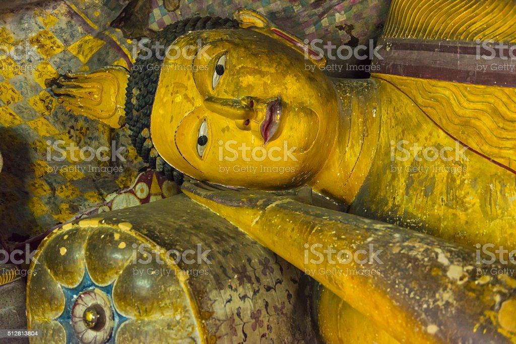 Reclining Buddha in Dambulla Golden Temple in Sri Lanka stock photo