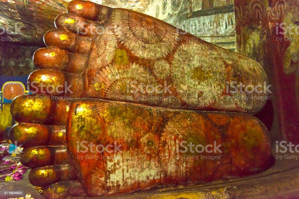 Reclining Buddhas' feet in Dambulla Golden Temple in Sri Lanka stock photo