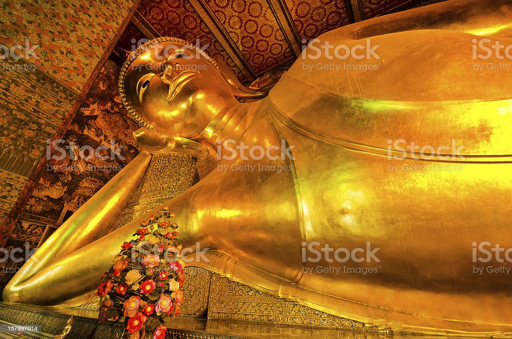 Reclining golden Buddha stock photo