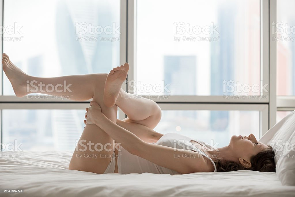 Reclining pigeon pose stock photo