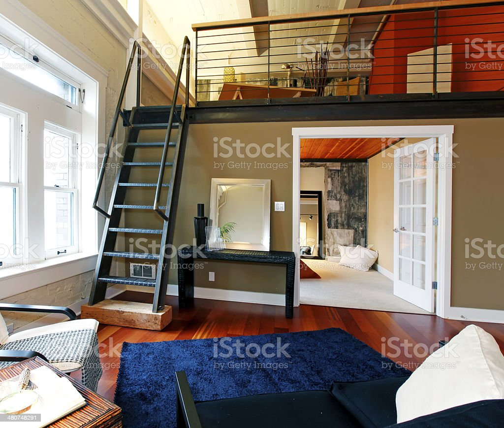 Reconstructed modern living room with mezzanine area stock photo