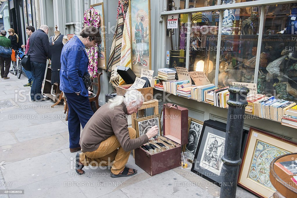 Record Collector Digs through Vinyl in Shoreditch Market stock photo