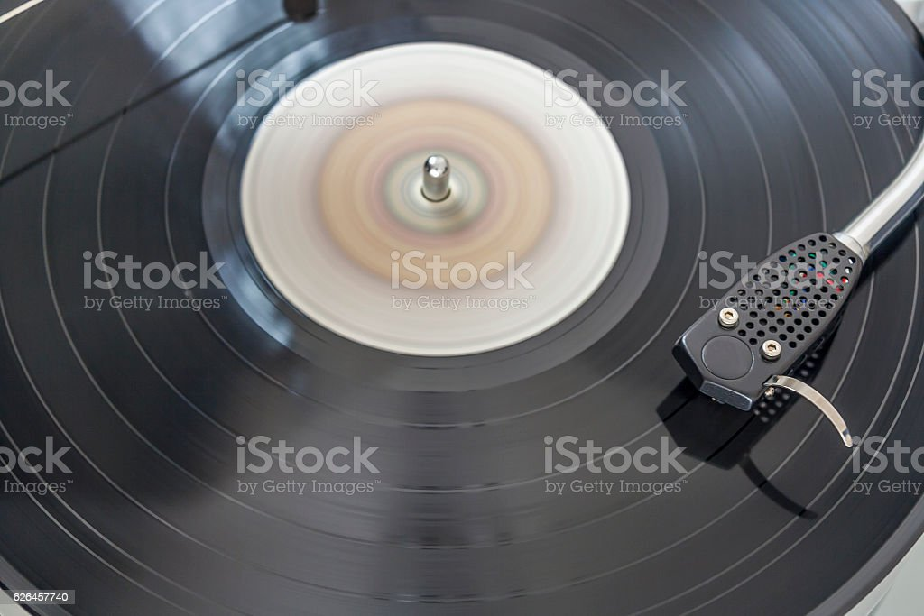 LP record spinning on turntable stock photo