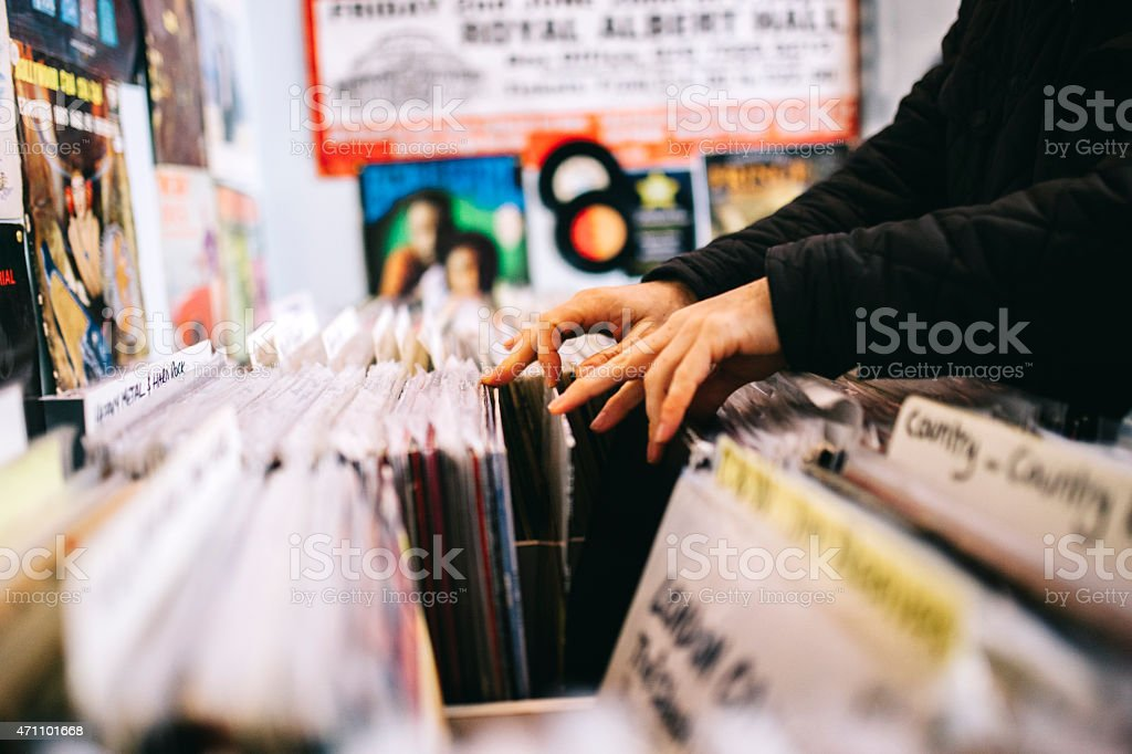 Record store, second hand vinyl records, hands searching stock photo