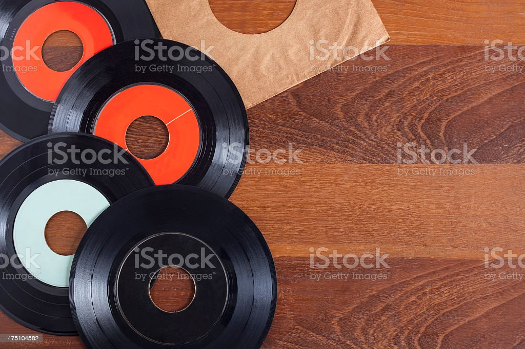 Record vinyl on wooden background stock photo
