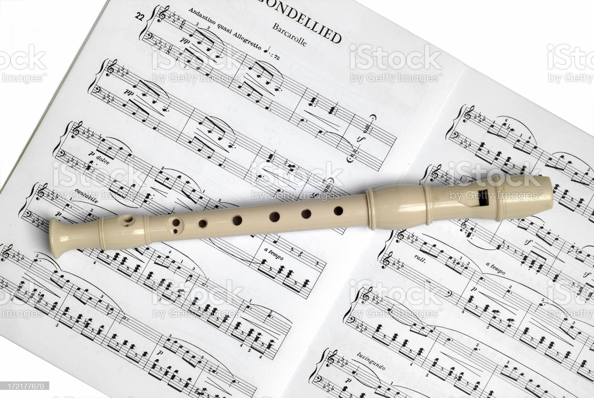 Recorder and sheet music on white royalty-free stock photo