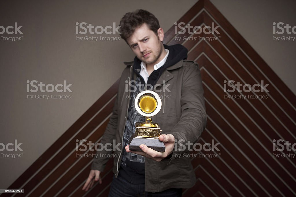 Recording Artist Showing Off Award stock photo