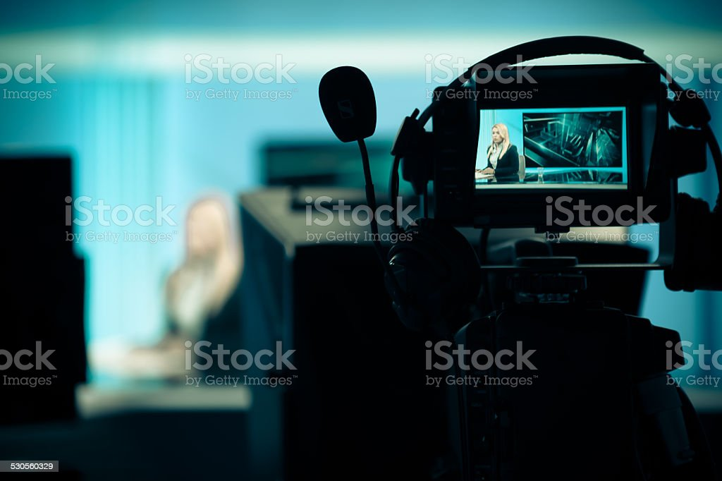 .Recording at TV studio with television anchorwoman stock photo
