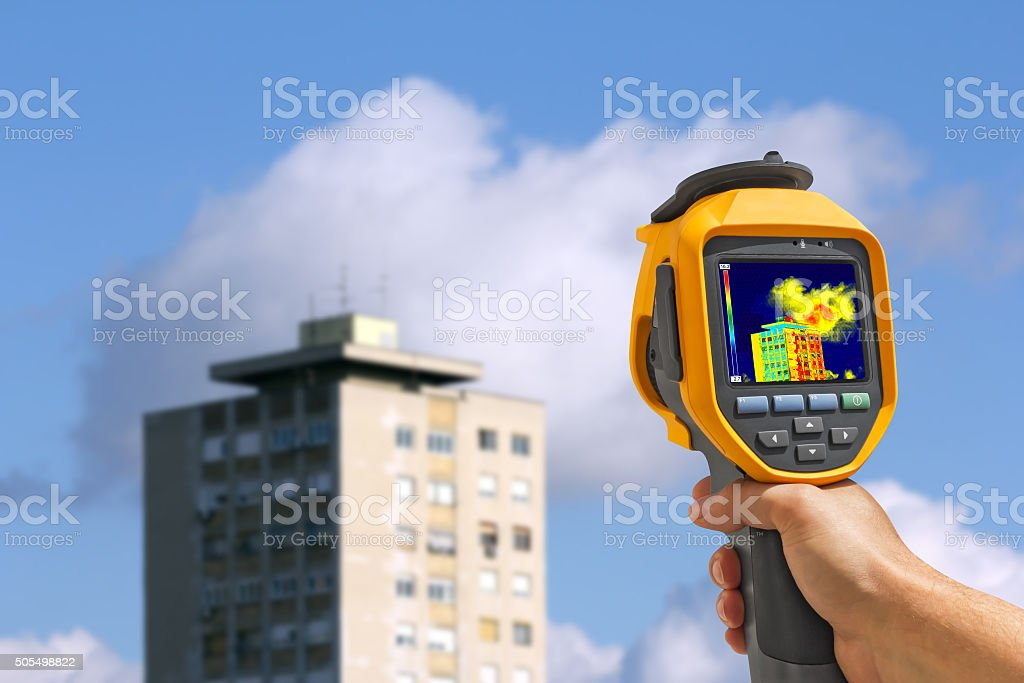 Recording Buildings With Thermal Camera stock photo