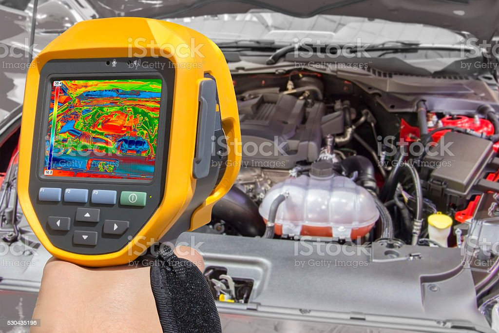 Recording Car Engine With Thermal Camera stock photo