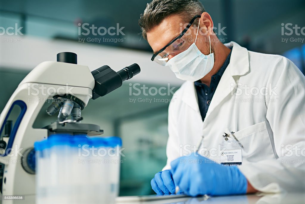 Recording his data for further analysis stock photo