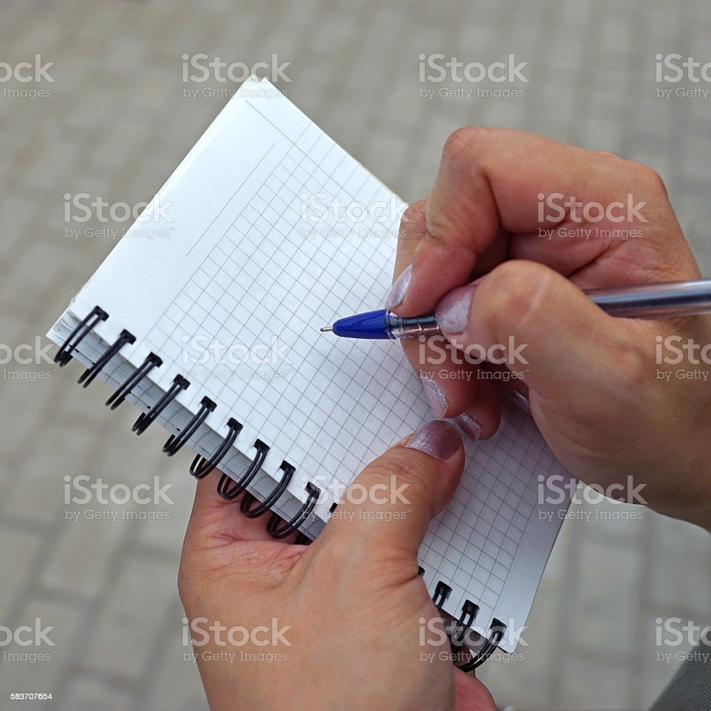 Recording pen in a notebook stock photo