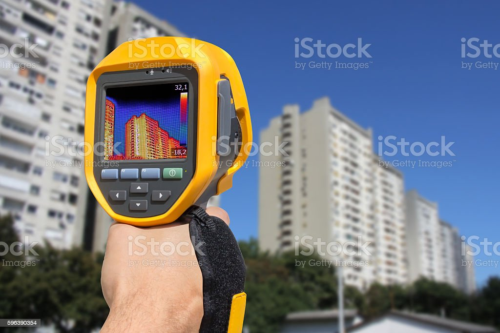 Recording Residential Buildings With Thermal Camera stock photo