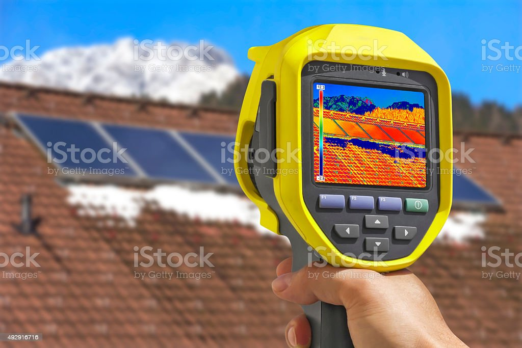 Recording Solar Panels with Thermal Camera stock photo