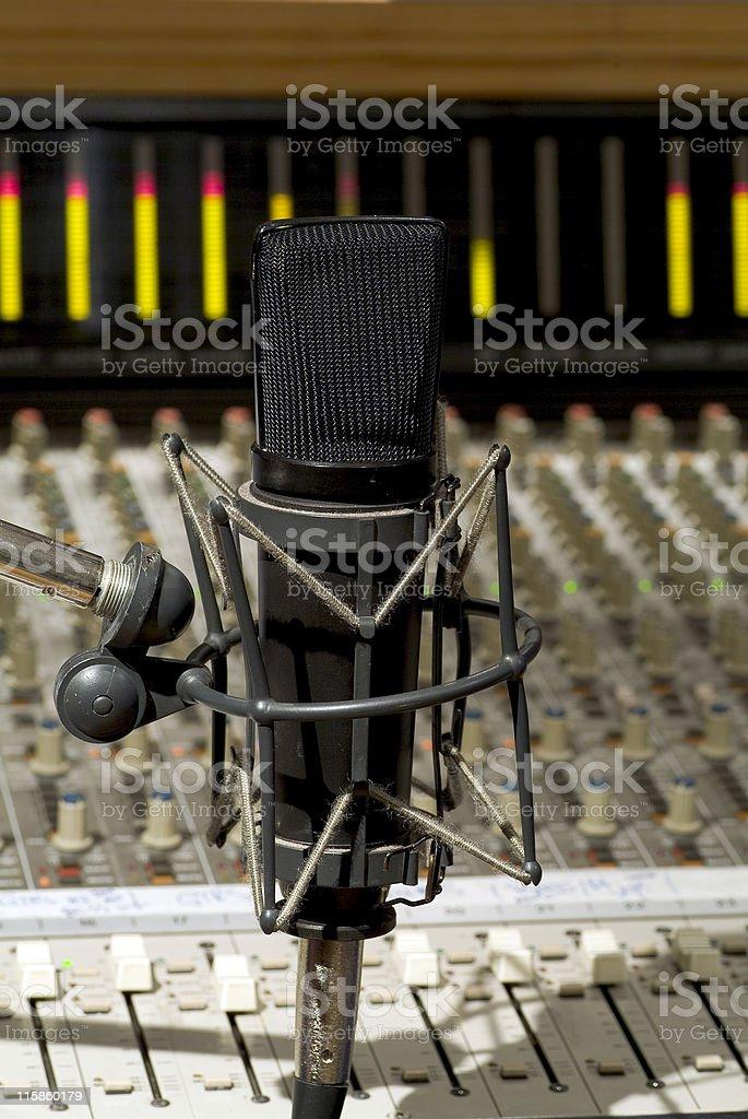Recording studio microphone with soundboard background stock photo