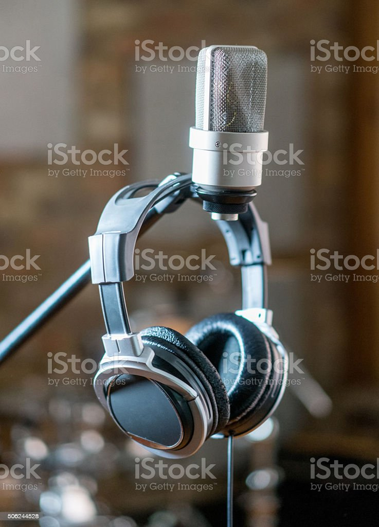 Vintage microphone at a recording studio with headphones - music...