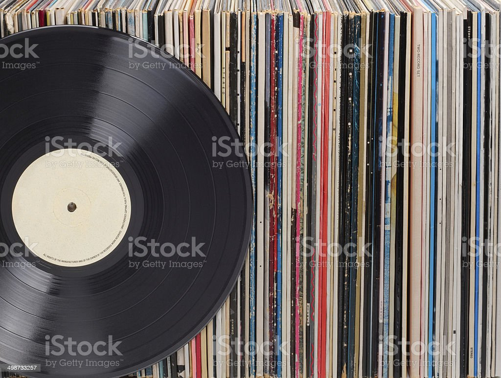 Records in a row, one in front stock photo