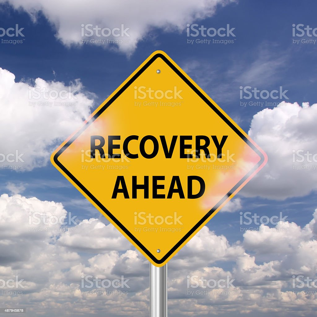 Recovery ahead warning sign stock photo