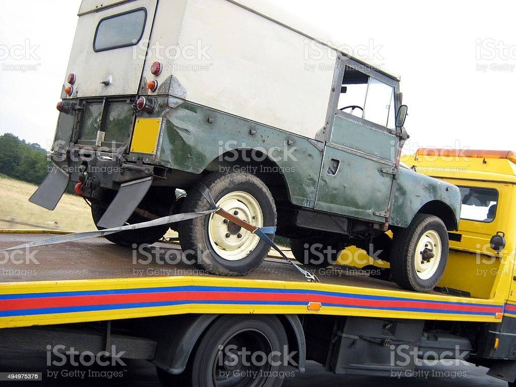 Recovery lorry transporting off road vehicle stock photo