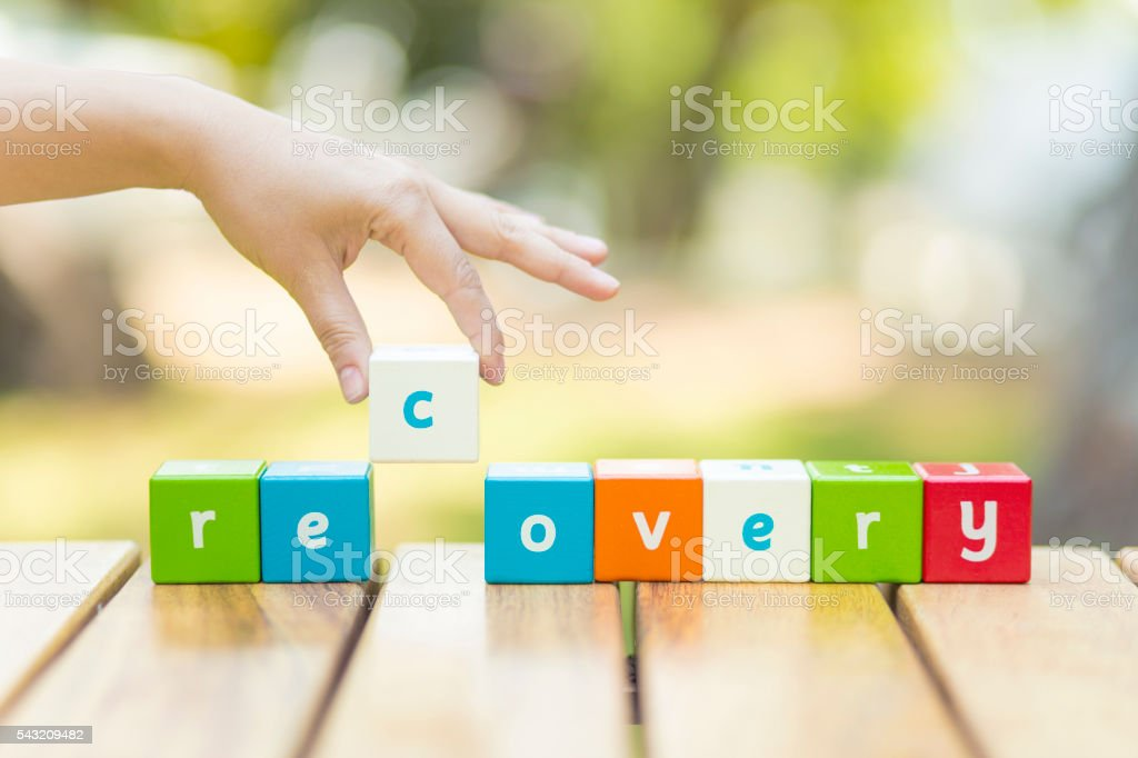 Recovery, word and hand stock photo