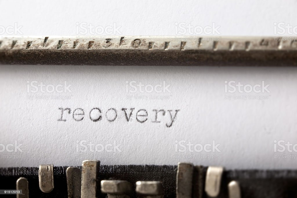 'Recovery' written on rusty and old typewriter royalty-free stock photo