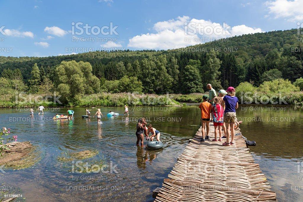 Recreating people near the riverside of river Semois, Belgium stock photo