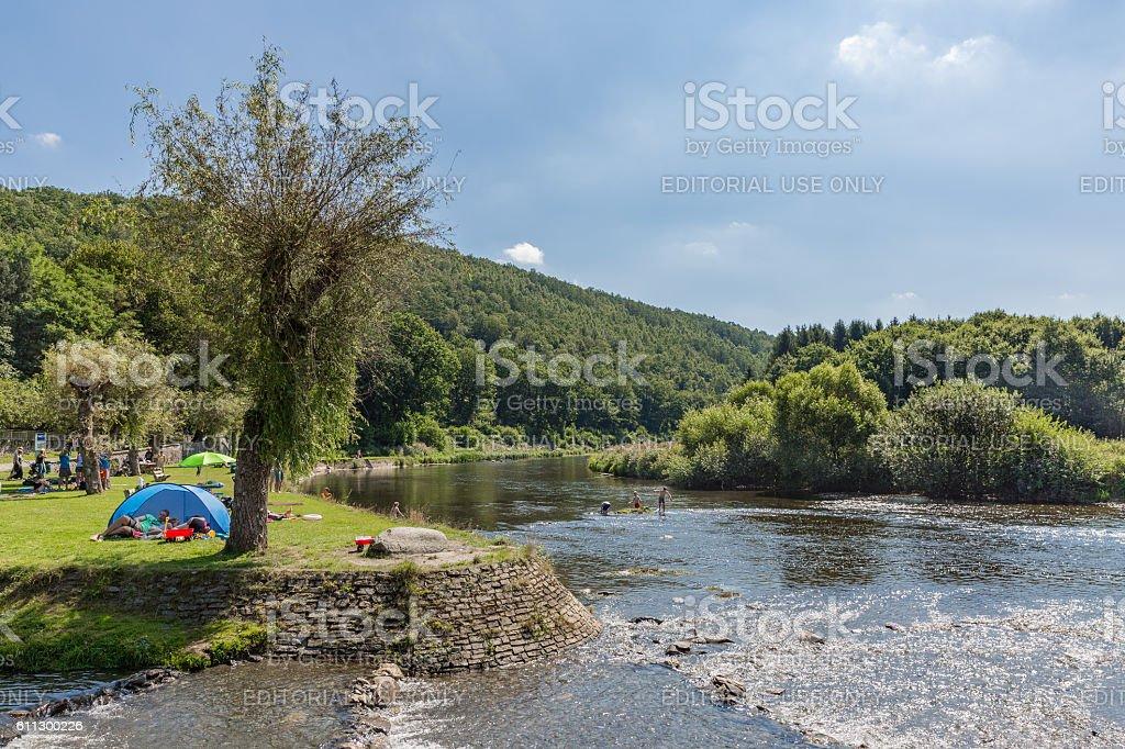 Recreating people near the riverside of the river Semois, Belgium stock photo