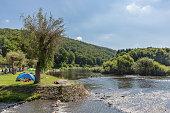 Recreating people near the riverside of the river Semois, Belgium