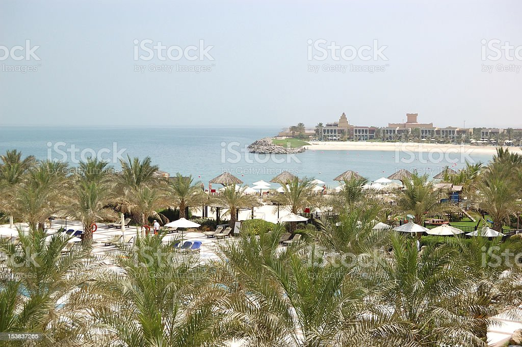 Recreation area of luxury hotel and beach with villas stock photo