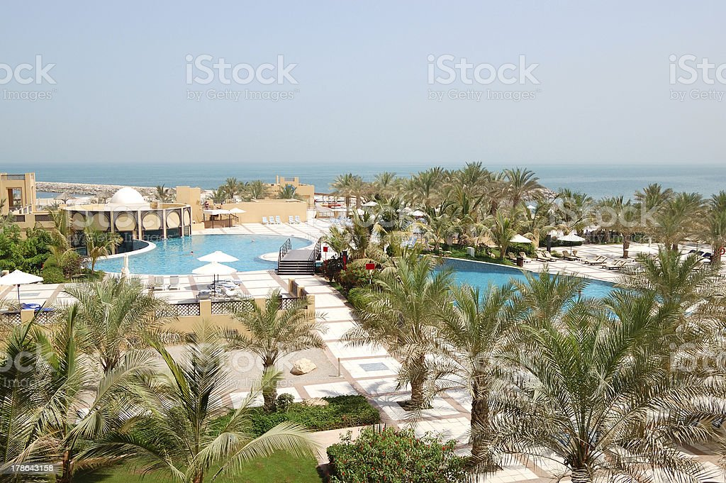 Recreation area of luxury hotel with swimming pools stock photo