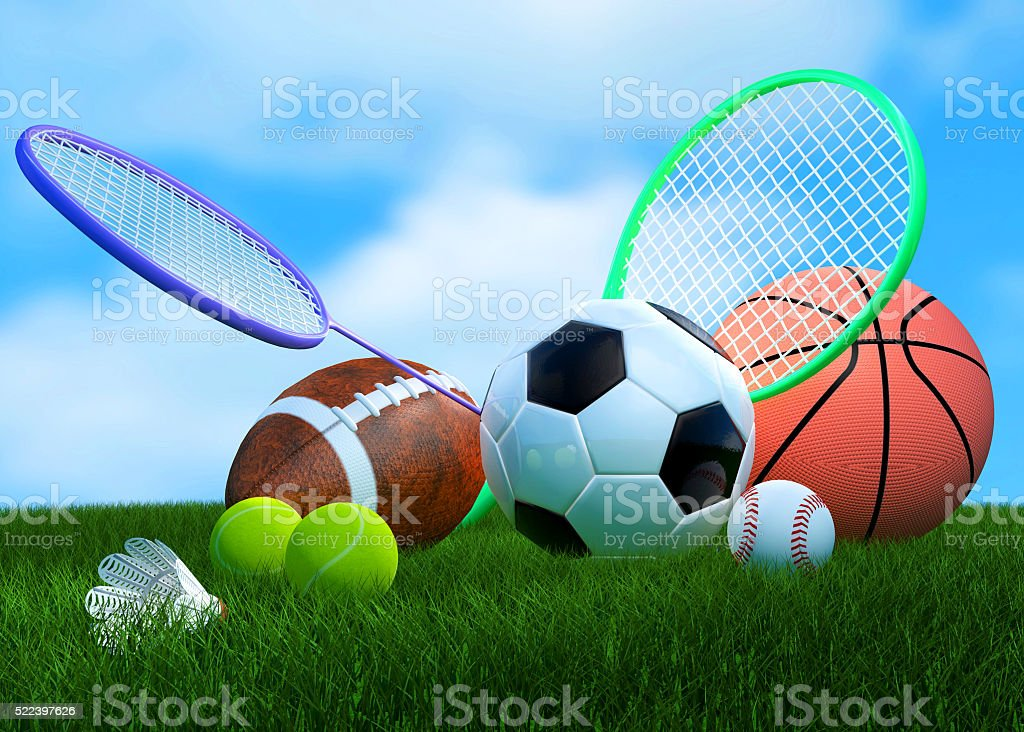 Recreation leisure sports equipment on grass with a football...