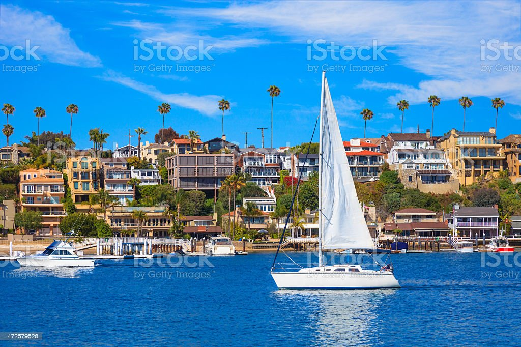 Recreational sailboat on Newport Bay at Newport Beach, CA stock photo