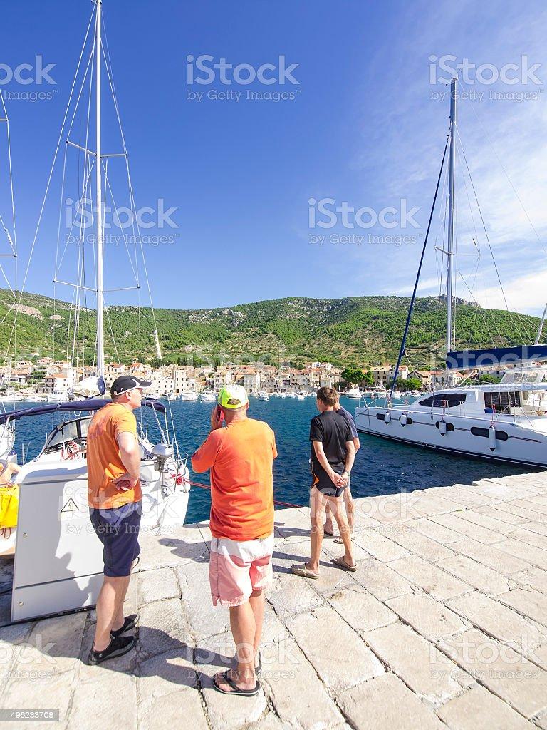 Recreational sailors on the pear of Komiza, Croatia stock photo