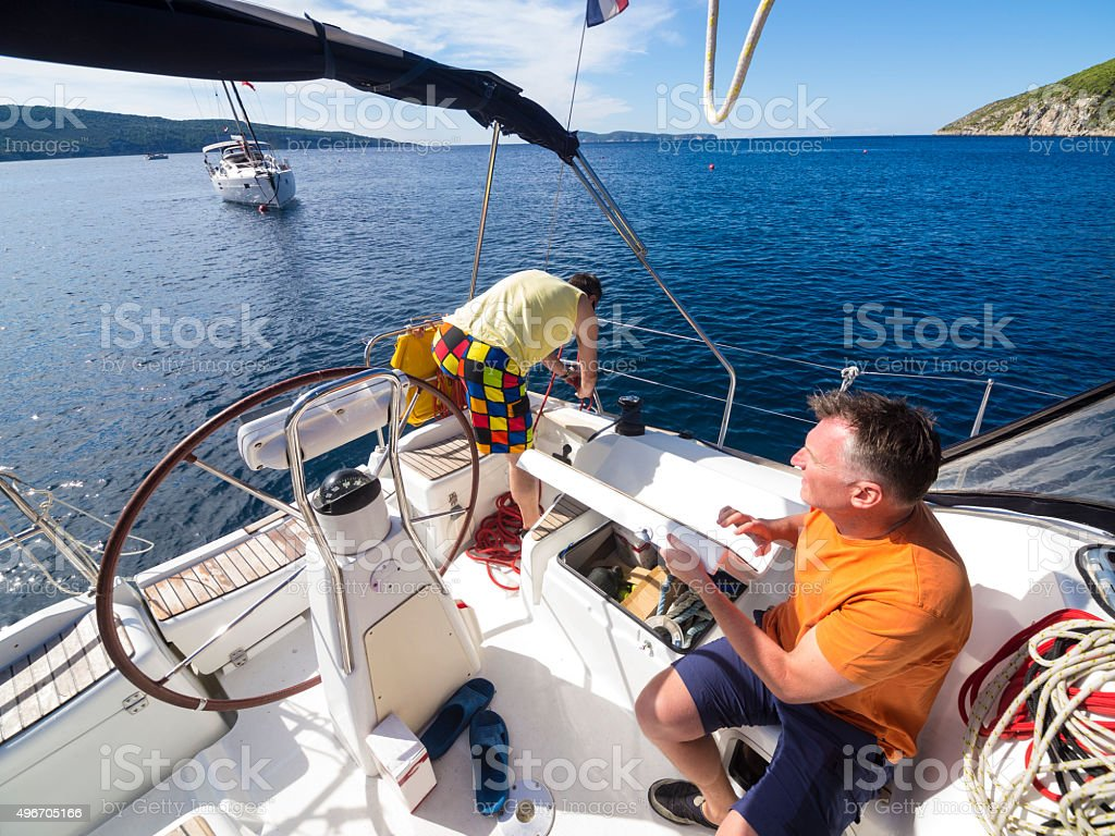Recreational sailors working ob boat whale in the Komiza Bay. stock photo