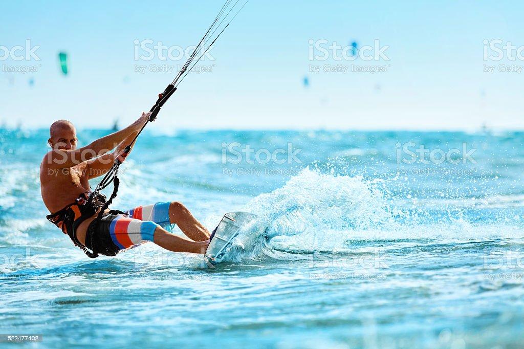 Recreational Sports. Man Kiteboarding In Sea Water. Extreme Sport stock photo