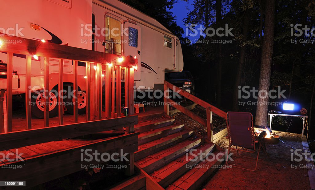 Recreational vehicle at campsite nightime royalty-free stock photo