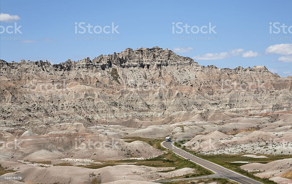 Recreational Vehicle Driving through the Badlands royalty-free stock photo