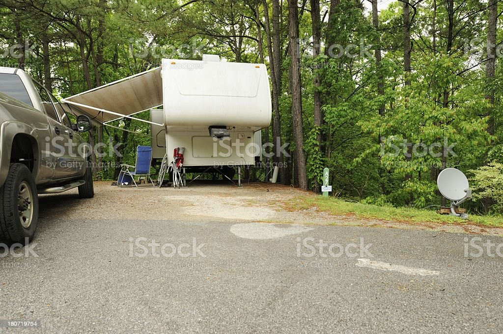 Recreational vehicle fifth wheel trailer in campsite royalty-free stock photo