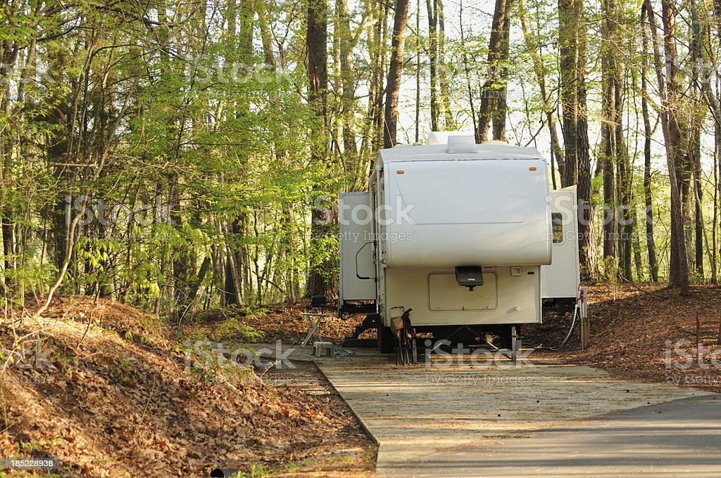 Recreational vehicle in campsite royalty-free stock photo