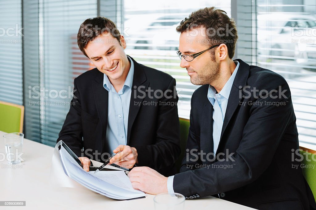 Recruiter checking assesment result stock photo