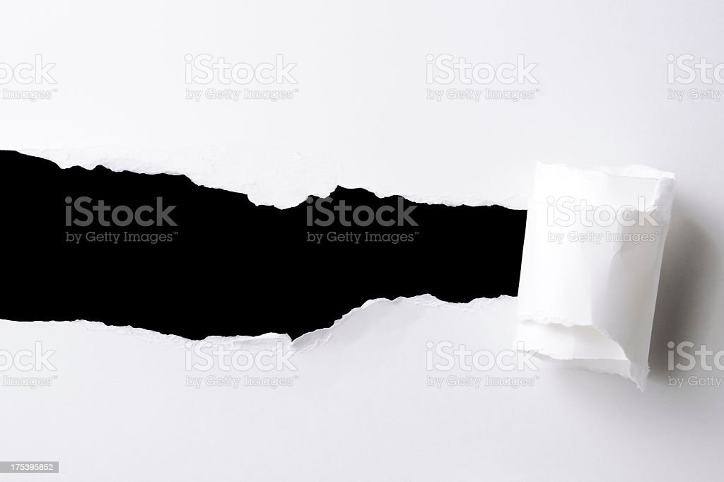 Rectangle hole in the white paper against black background stock photo