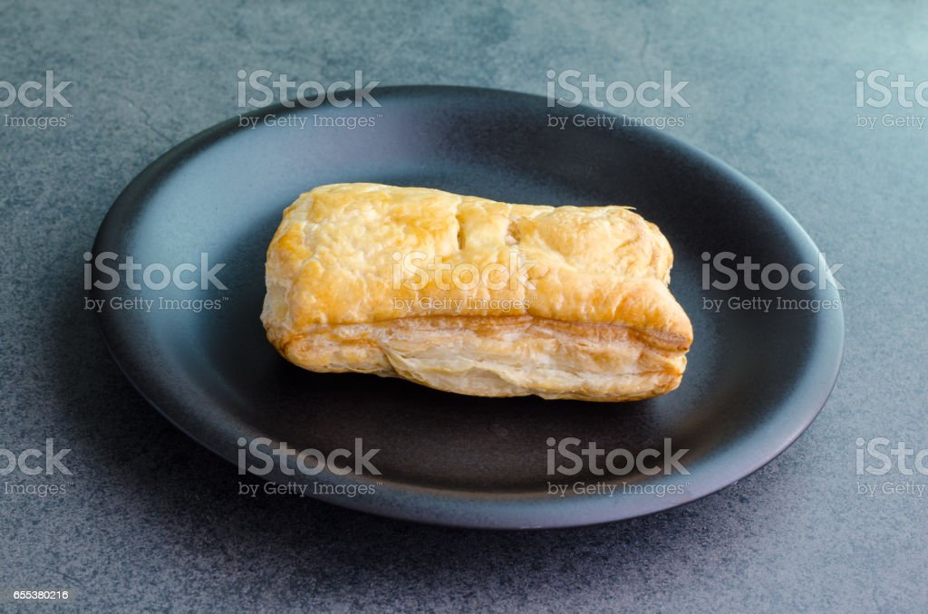 Rectangular baked bread on plate on stone background stock photo