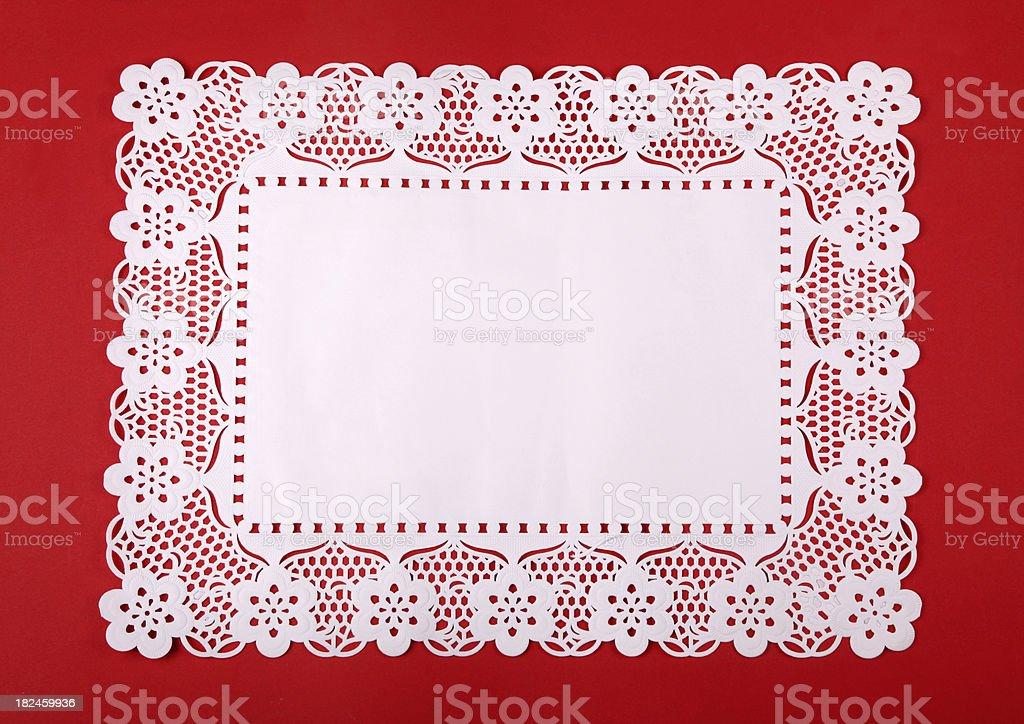 Rectangular doily on red cardboard stock photo