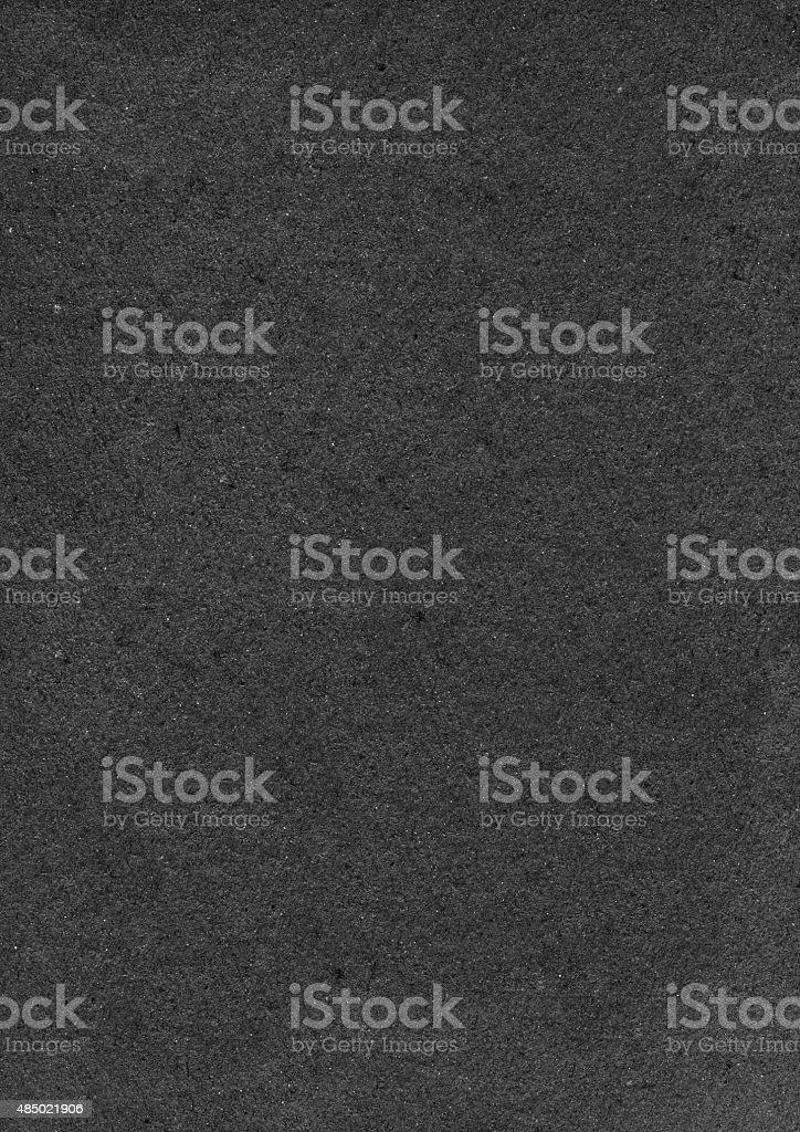 Rectangular rugged freaked black sandpaper card - high resolution background stock photo