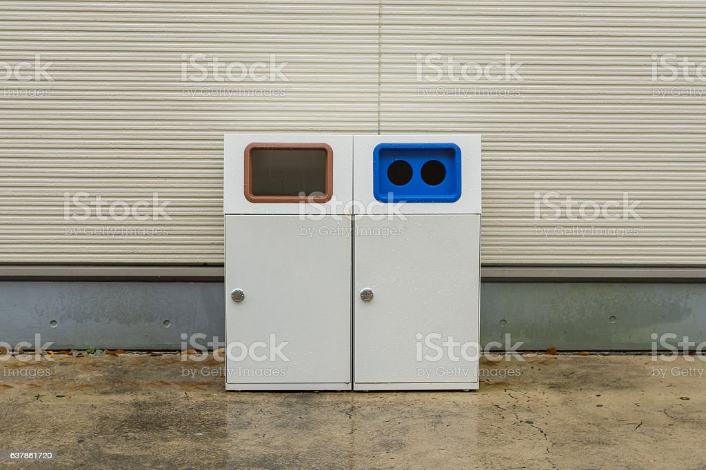 Recycle bin in front of store in Japan stock photo