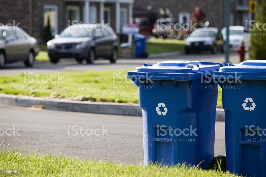 Recycle bin in front of the street stock photo