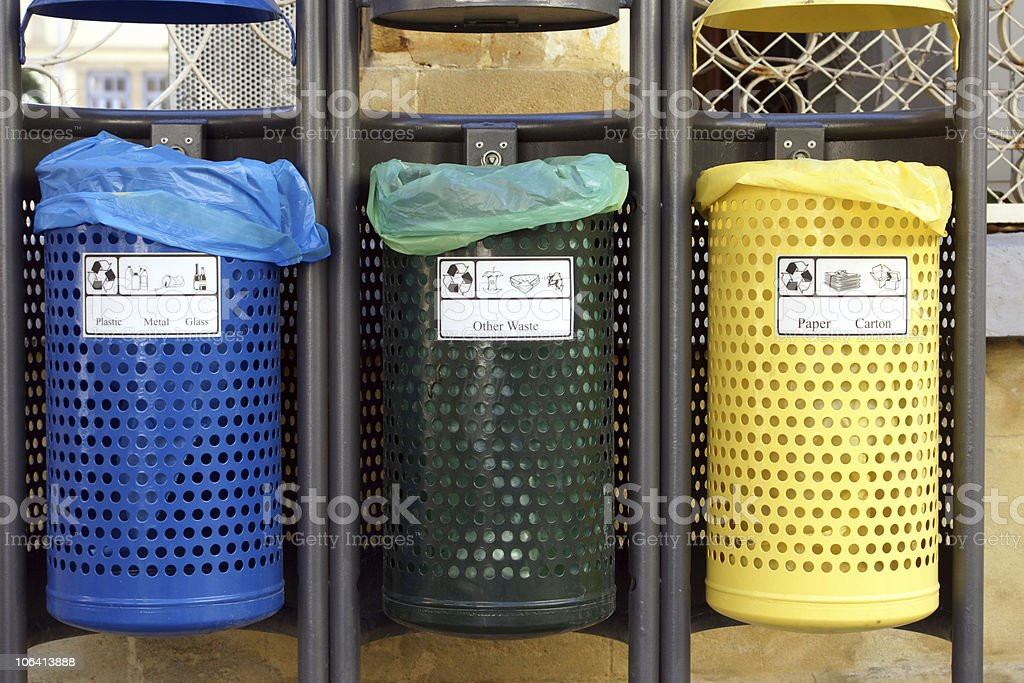 Recycle bins for paper,glass,metal,plastic stock photo